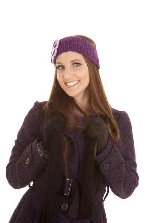 A woman with a smile on her face in her winter coat and hat. Stock Photo - 16242805