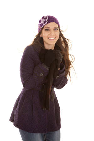 A woman in her winter coat and hat with the wind blowing with a smile on her lips. Stock Photo - 16242839