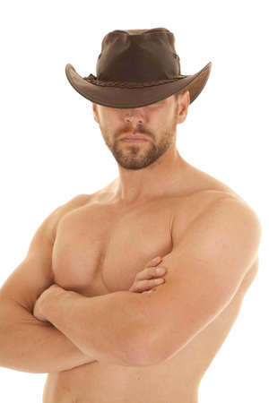 A cowboy without a shirt on and with his brown cowboy hat on. photo