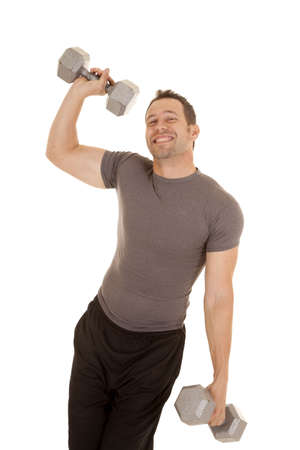 A man being a wimpy kind of guy not being able to lift big weights. photo