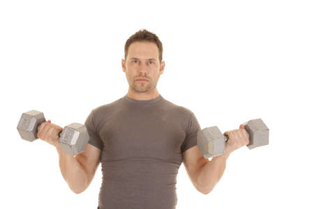 A man lifting two big weights with a serious expression on his face. photo
