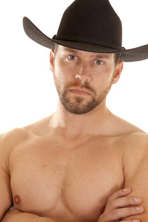 A close up of a cowboys face and chest, while he is wearing his black cowboy hat. photo
