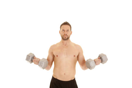 A man working out with weights, working out his arms without a shirt on. photo