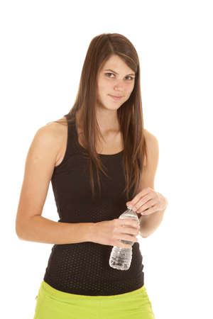 a woman holding on to her water bottle getting ready to have a drink. photo