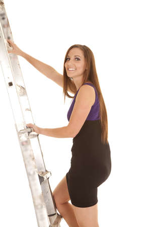 a woman climbing up a ladder to success in either business or school. photo