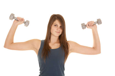 A woman with a small smile on her face lifting weights. Stock Photo - 18187072