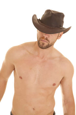 A cowboy without his shirt on looking away. photo