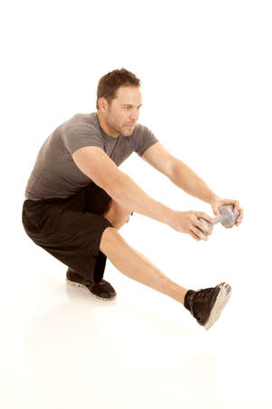 a man doing a one leg squat and holding on to a weight. photo
