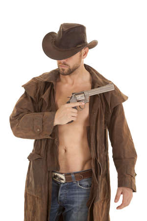 A man in his western duster and hat holding on to a pistol
