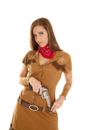 A woman putting her pistol in her western belt. photo