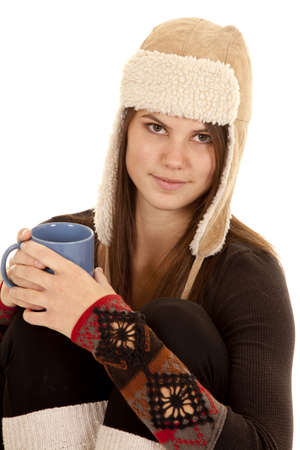 long johns: A close up of a woman in her warm hat and long johns holding a warm cup of a drink.