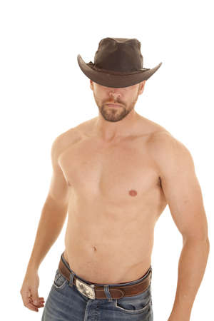A cowboy without his shirt on with a serious expression on his face. photo