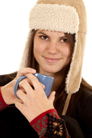long johns: A woman with a smile on her face holding on to a mug Stock Photo