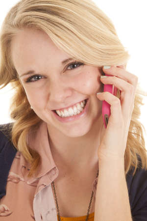 big smile: a woman talking on the phone with a big smile on her face.