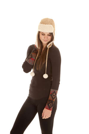 long johns: A woman standing up in her warm clothes and hat with a small smile on her lips. Stock Photo