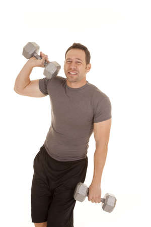 a man showing his wimpy side and not wanting to work out. photo