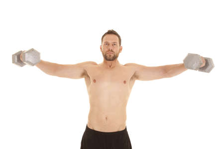 A man holding out weights doing a shoulder fly with a serious expression on his face photo