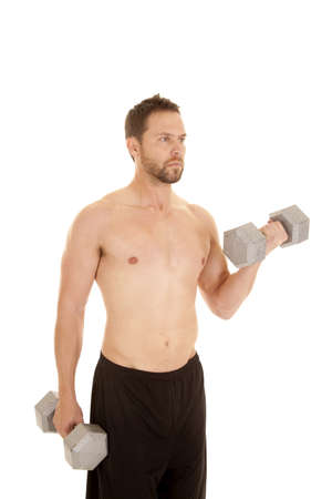A man lifting weights to do arm curls and build up his arms. photo