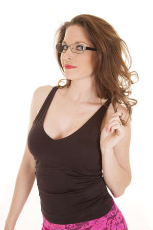 A woman in a black tank top wearing a pair of glasses. photo