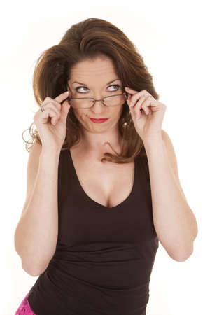 chest hair: A woman is holding onto her glasses and looking to the side. Stock Photo