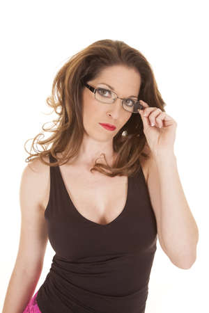 A woman is looking through her glasses with a serious expression. photo