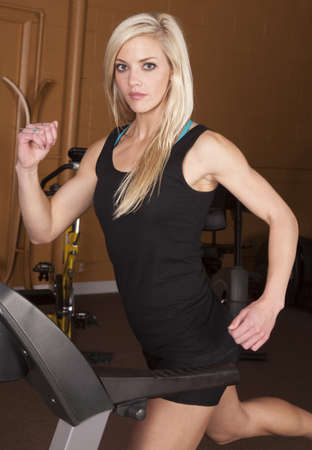 A woman running on the treadmill in the gym. photo