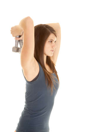 A woman working out her tricepts with weights. photo