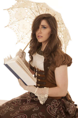 A woman in her vintage clothing reading a sad story holding on to her umbrella photo