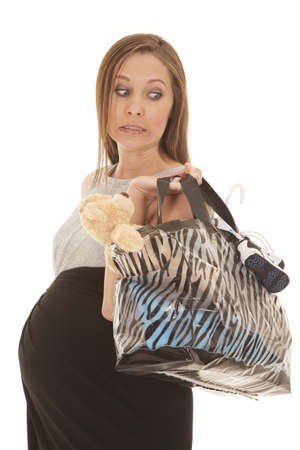 A woman expecting a baby just finished shopping photo