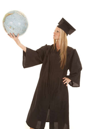 A graduate female holding on to the world in her hand. photo