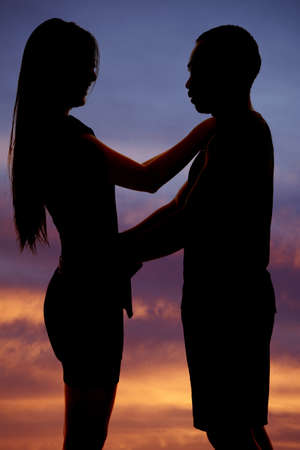 A silhouette of a man and woman in each others arms photo