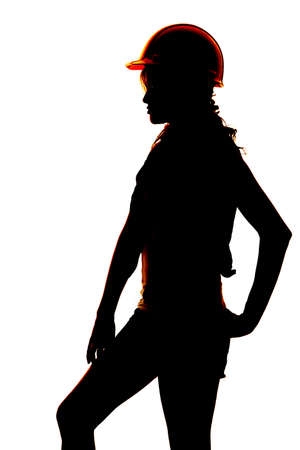 hard: A silhouette of a woman with her hard hat on.