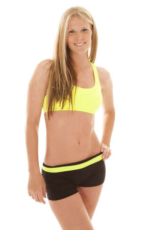 A woman with her fitness clothes on with a smile on her lips. photo