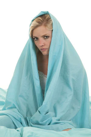 snug: a woman with a sheet wrapped around her head with a serious expression