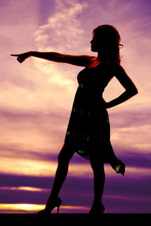 a silhouette of a woman pointing with a serious expression on her face. Stock Photo - 20964737
