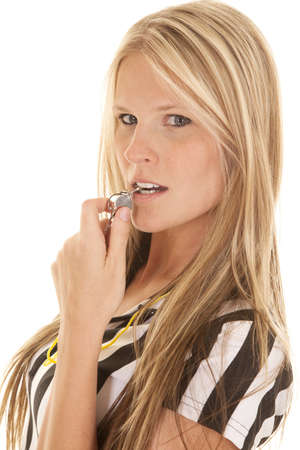 A close up of a woman with her whistle in her mouth. Stock Photo