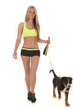 mountain dog: a woman walking and getting exercise for both herself and her Swiss mountain dog.