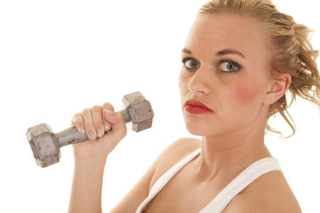 A close up of a woman holding on to a weight with a serious expression photo