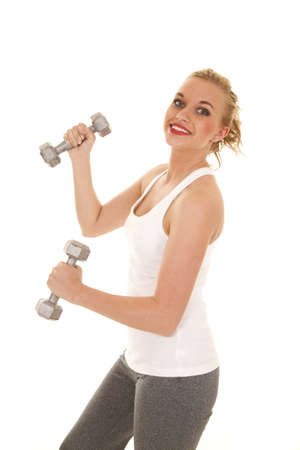 a woman working out with a smile on her face. photo