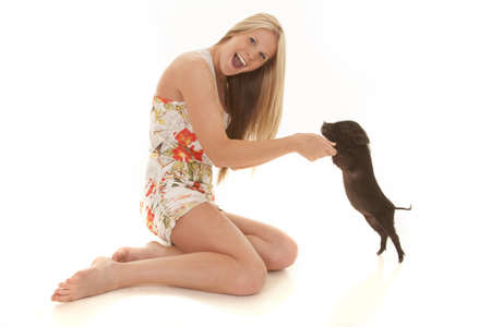 a woman dancing with her pet pig, she has a smile on her face photo