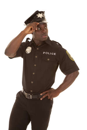Police officer looking back over his shoulder.