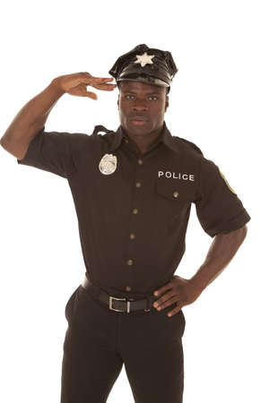 Police officer soluting with a serious expression.