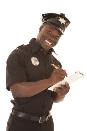 A policeman writing a ticket while smiling. Stock Photo