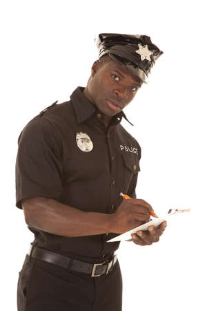 A policeman writing a ticket with a serious expression
