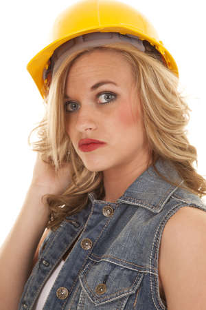 a woman with her construction hat on with a serious expression on her face photo