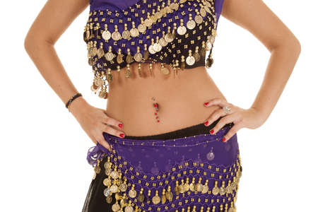 a belly dancer with her hands on her hips. photo
