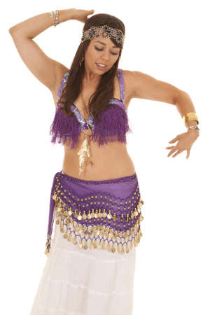 A woman belly dancing and moving around. photo