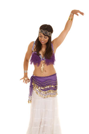 a woman with a smile on her face belly dancing photo