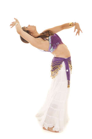a woman leaning back while she is belly dancing photo
