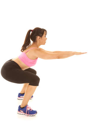 A woman working out and getting stronger by doing a squat  photo